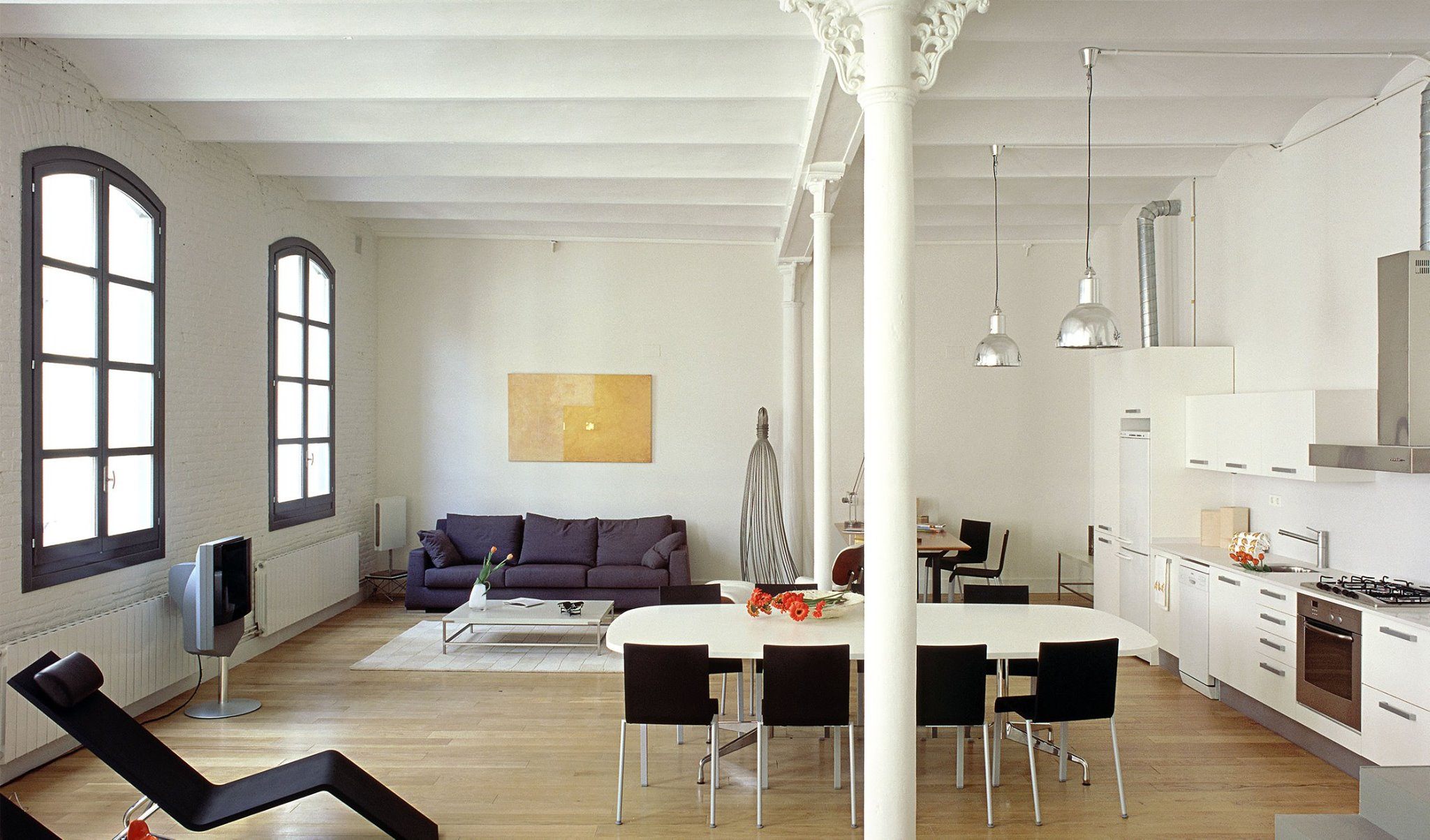 Loft Passatge Sert from Sara Folch Interior Design focusing on the space, light and order motto